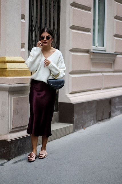 With white loose sweater, black bag and marsala satin midi skirt
