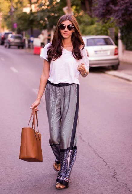 With white loose t shirt, brown leather tote bag and flat sandals