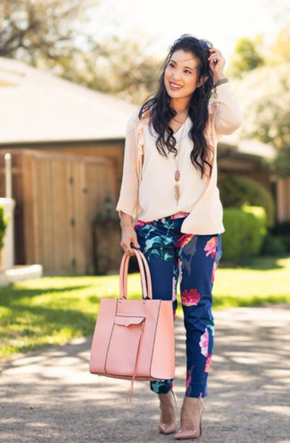 With white loose top, pale pink cardigan, floral pants and beige patent leather shoes