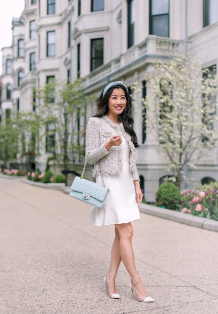 With white mini dress, beige tweed jacket, light blue headband and pumps
