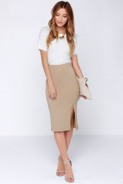 With white shirt, beige clutch and beige ankle strap shoes