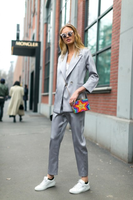 With white shirt, colorful bag, light gray blazer and white sneakers