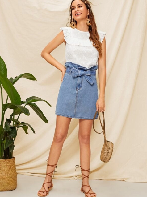 With white sleeveless top, rounded bag and lace up flat sandals