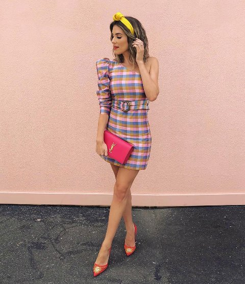 With yellow headband, pink clutch and red and golden pumps