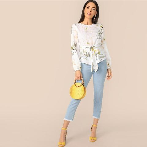 With yellow rounded bag, cropped jeans and yellow high heels