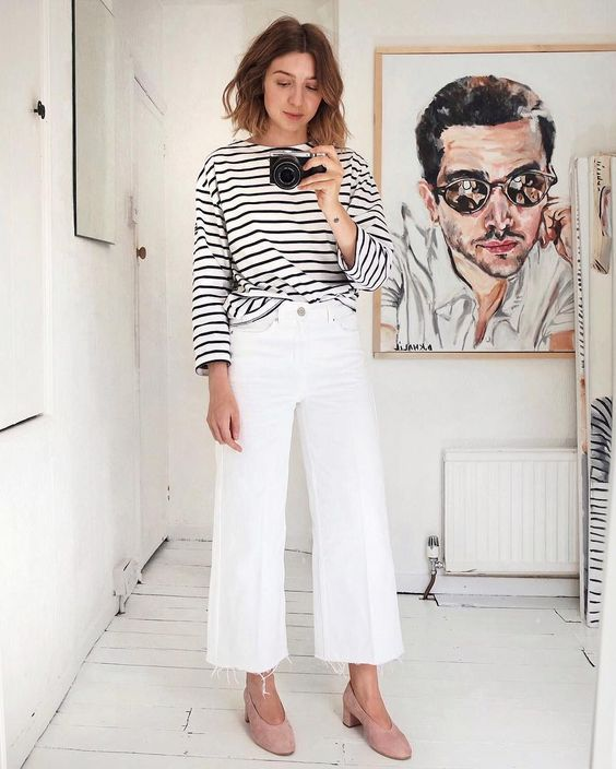a Breton stripe top, white flare jeans, blush heels for a refined and stylish outfit