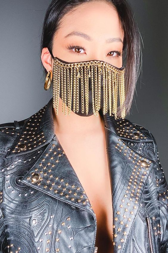 a black face mask with chains is a bold statement and addition to a rock-style look
