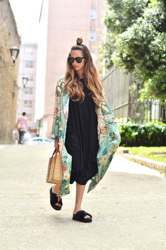 a black midi dress, black birkenstocks, a green floral kimono and a wicker bag for a relaxed look