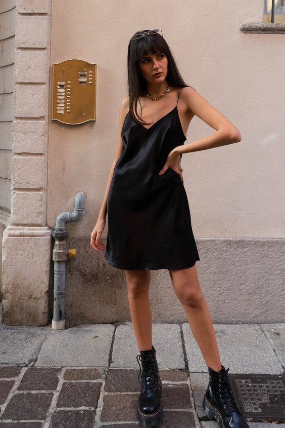 a black slip mini dress, black combat boots for a rock babe outfit