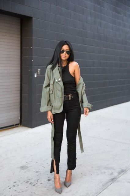 a black top, black jeans with slits, grey heels and a green army jacket for a chic casual look