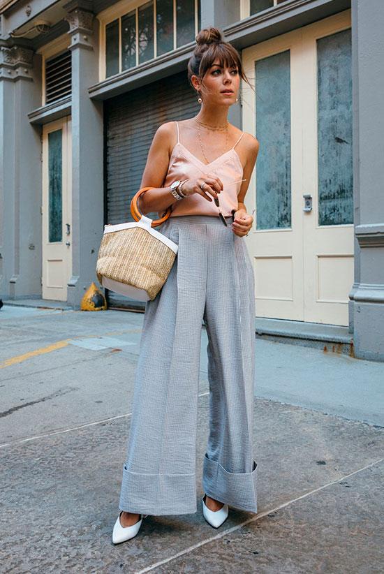 a blush spaghetti strap top, powder blue wideleg pants, white shoes, a woven bag and chic earrings