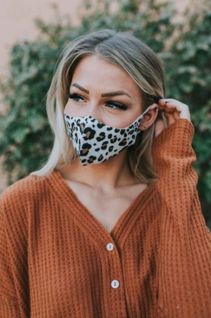 a bold leopard print face mask like this one will add an accent to your look