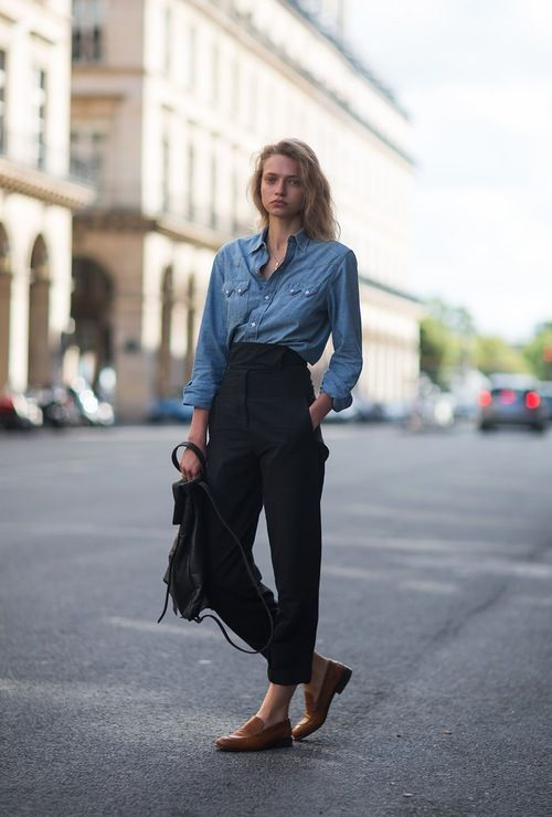 a business casual look with a chambray shirt, black high waisted trousers, brown moccasins and a black backpack
