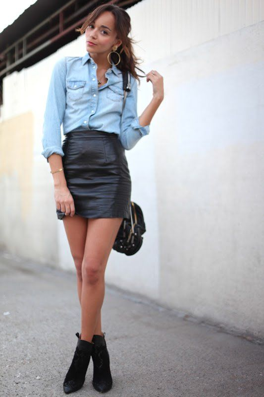 a chambray shirt, a black leather mini, black suede booties and a black bag for a casual spring look