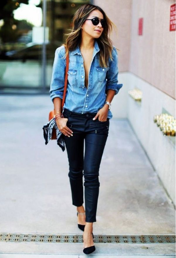 a chambray shirt, black leather pants, black heels and a brown bag for a spring or summer look