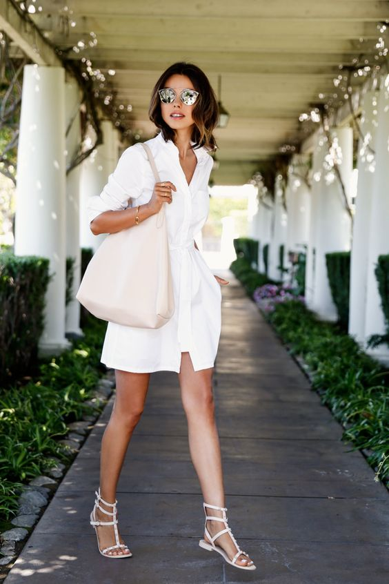 a cool and simple vacation look with a white shirtdress with pockets and a sash, white sandals and a large ivory tote