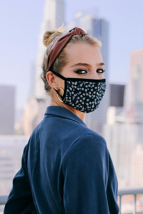 a dark floral face mask will give a feminine feel to the look and will add print to the outfit