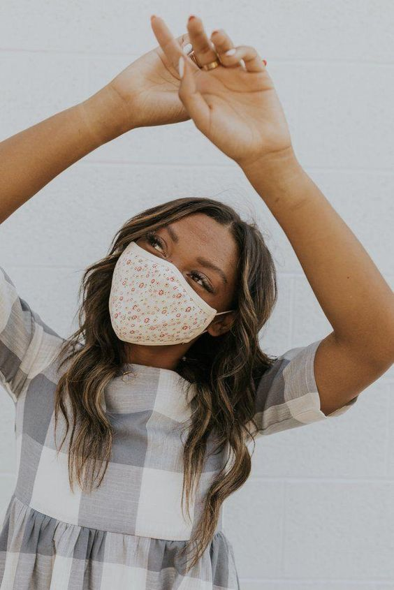 a delicate floral print face mask will match many outfits without looking too obtrusive