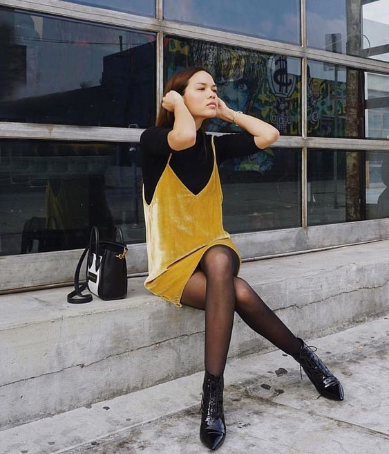 a fall look with a black top, a mustard mini slip dress, black boots and a black bag