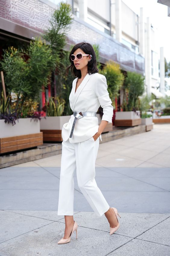 a fantastic work look with a white pantsuit, a silver belt, nude heels and blush sunglasses