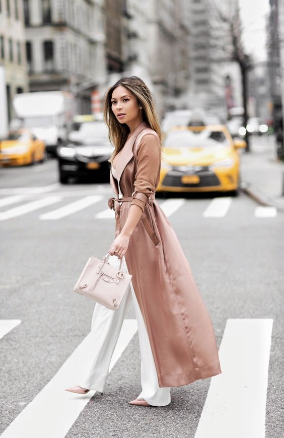 a glam look with a white top, white palazzo pants, blush heels, a dusty pink duster and a blush bag