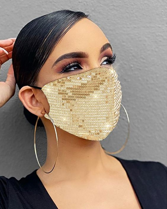 a gold sequin face mask will add a glam touch to your look and will make it really bright and shiny