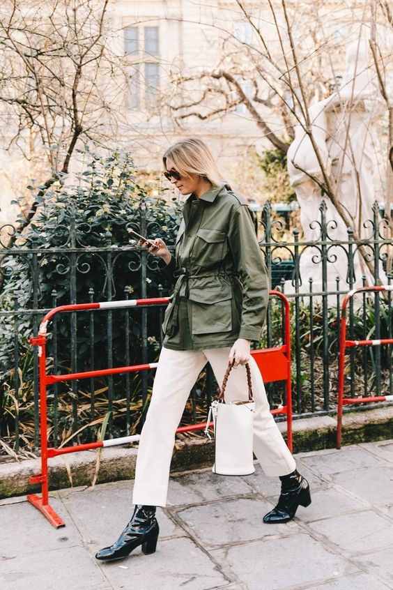 a green army jacket, white jeans, black boots, a black bucket bag for a stylish spring look