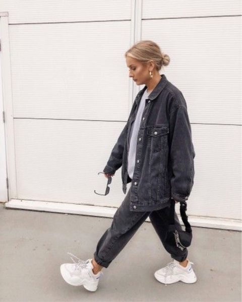 a grey oversized tee, a black oversized denim jacket and matching jeans, white ugly sneakers for every day