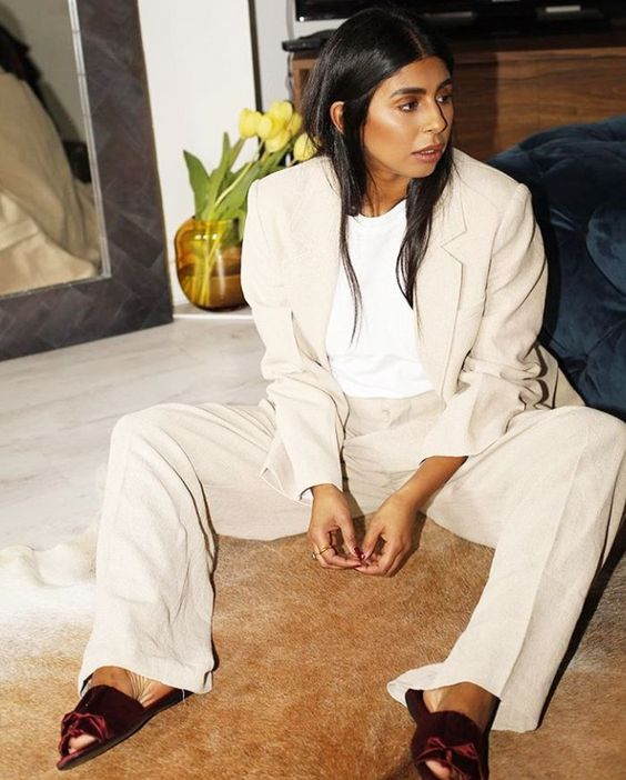 a lovely look with a neutral linen suit with an oversized blazer, a white t shirt, burgundy slippers