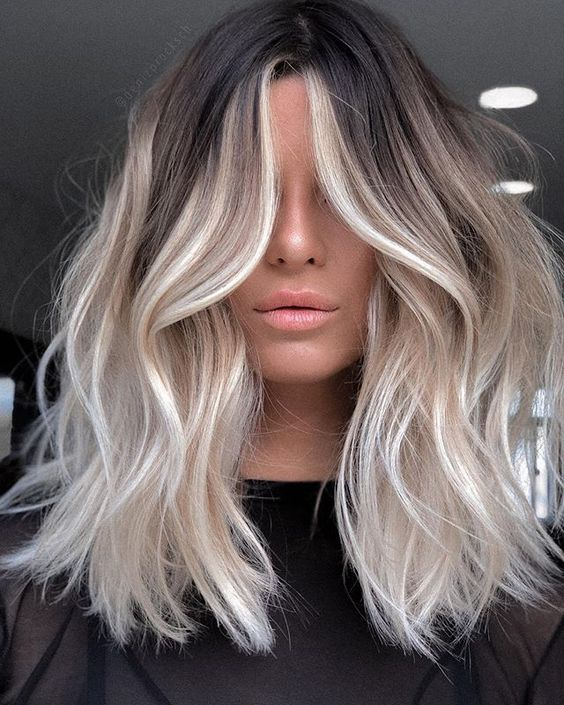 a low-maintenance rooty icy blonde with light waves and a bit of beach texture is fabulous