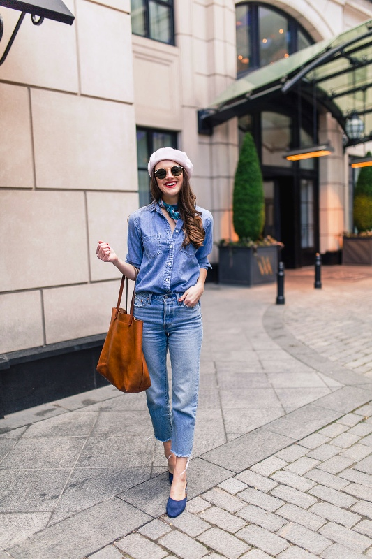 a pretty double denim look with a chambray shirt, blue jeans, blue heels, a beret abd a leather tote