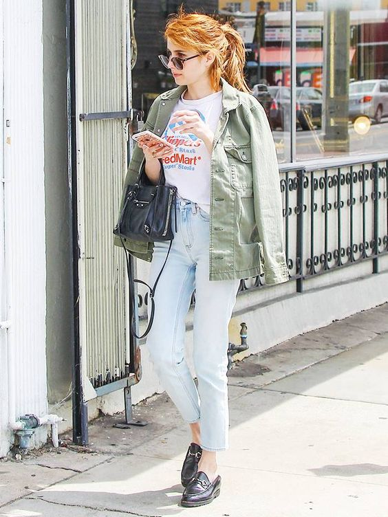 a printed t-shirt, light blue jeans, black moccasins, a green army jacket and a black bag