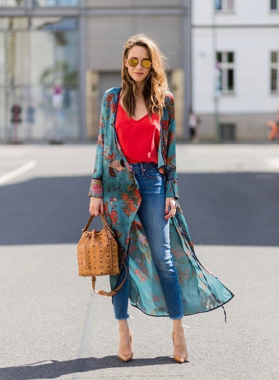 a red top, blue skinnies, nude shoes, a green floral kimono and a brown bag
