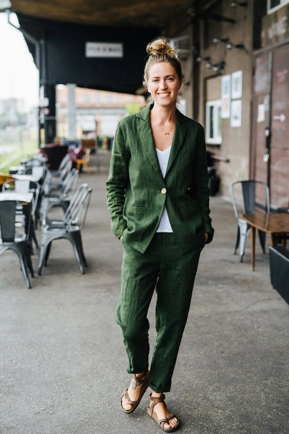 a relaxed summer look with a grene linen suit, a white top, brown strappy sandals is cool