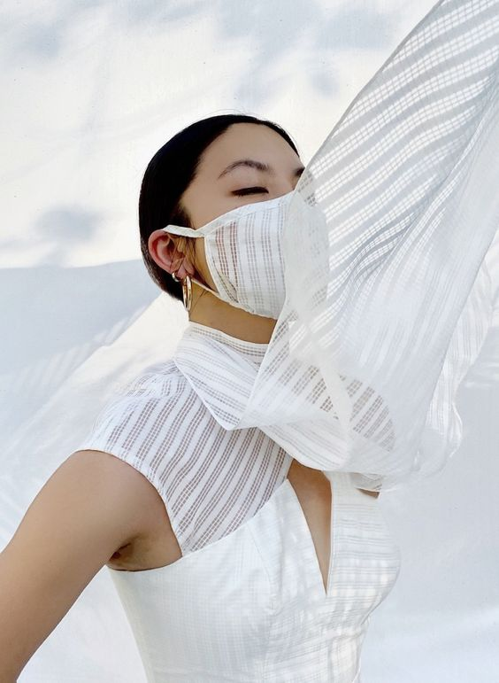a simple and pretty white fabric mask won't look heavy on your face and will protect you with style