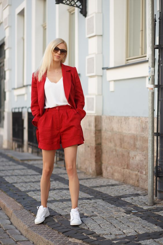 a simple summer look with a red linen shorts suit, a white top, white sneakers is a bold outfit for summer