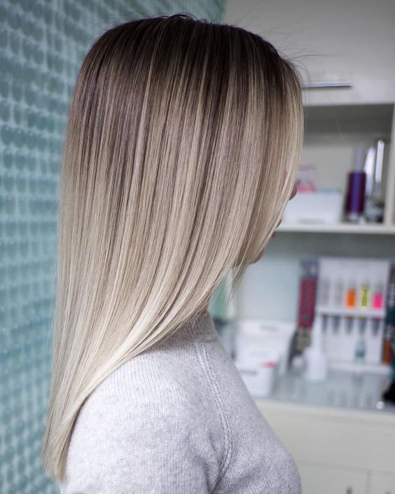 a soft and stylish ombre from darker root to silver champagne and icy blonde is a lovely and chic idea
