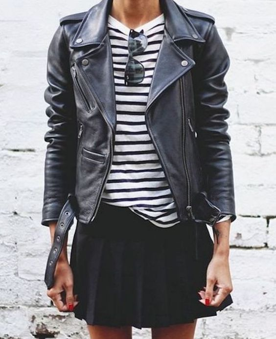 a striped black and white top, a black leather jacket, a black pleated mini for a stylish and cool look