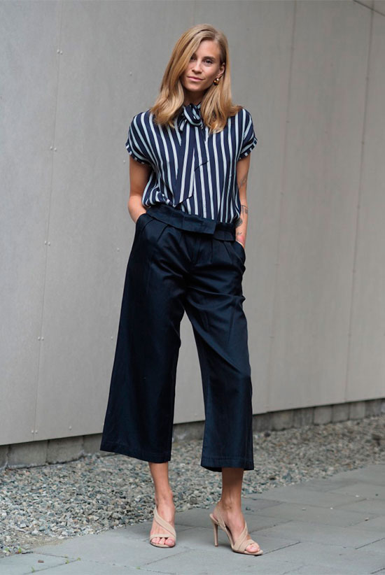 a striped navy and white bow blouse, navy culottes and catchy nude shoes for a wow effect