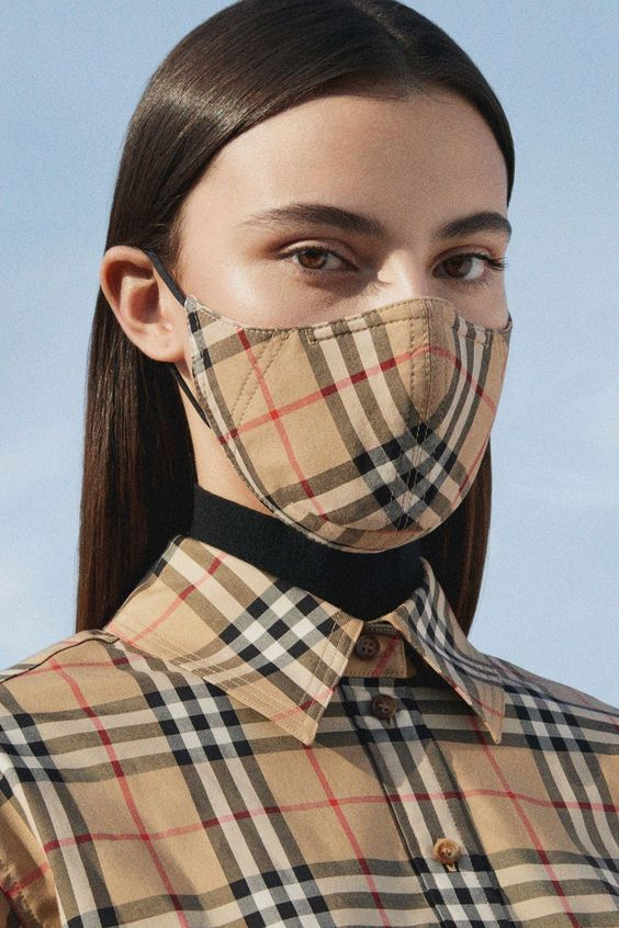 a stylish and timeless tan plaid printed mask that matches the shirt for a cohesive and timeless look
