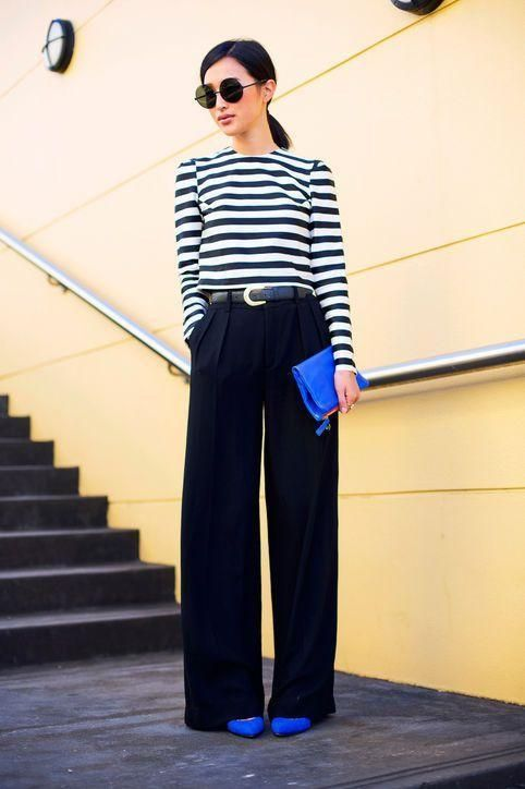 a stylish work look with a striped long sleeve top, black palazzo pants, electric blue shoes and a clutch