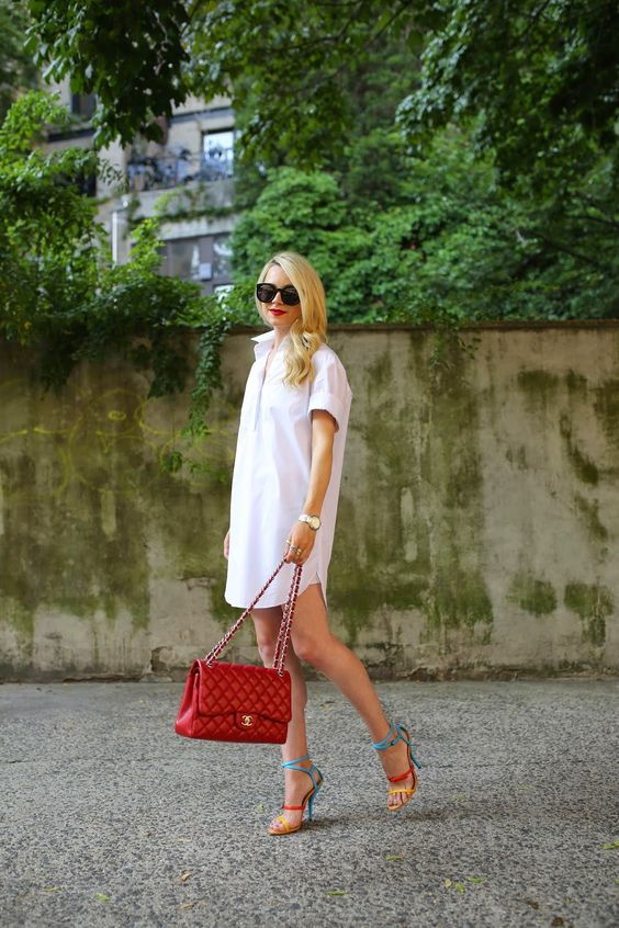 a summer look with a crispy white shirtdress, colorful heels and a bold red bag plus a red lip