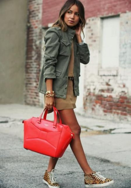 a tan top, tan mini skirt, a green army jacket, a hot red tote for a bold accent is a lovely idea