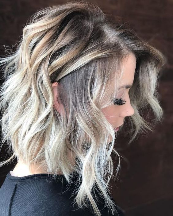 a tousled layered blonde balayage lob si a fresh take on lob with bleached locks and tousled styles