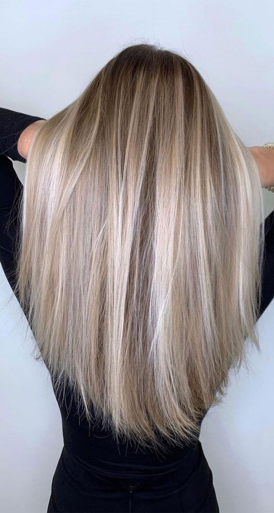 a warm blonde balayage wtih a dark root and ciry blonde and silver champagne touches is amazing