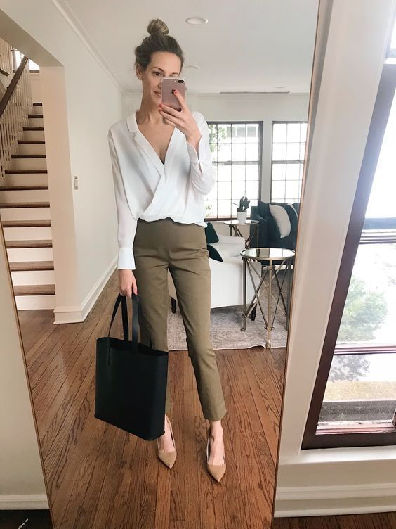 a white blouse, olive green pants, tan shoes and a black tote for a simple and comfy work look
