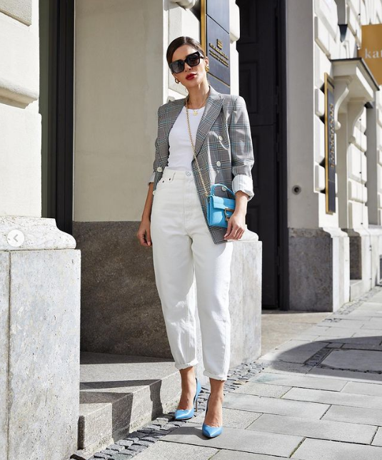 a white halter neckline top, white jeans, a grey plaid blazer, blue shoes and a blue bag on chain