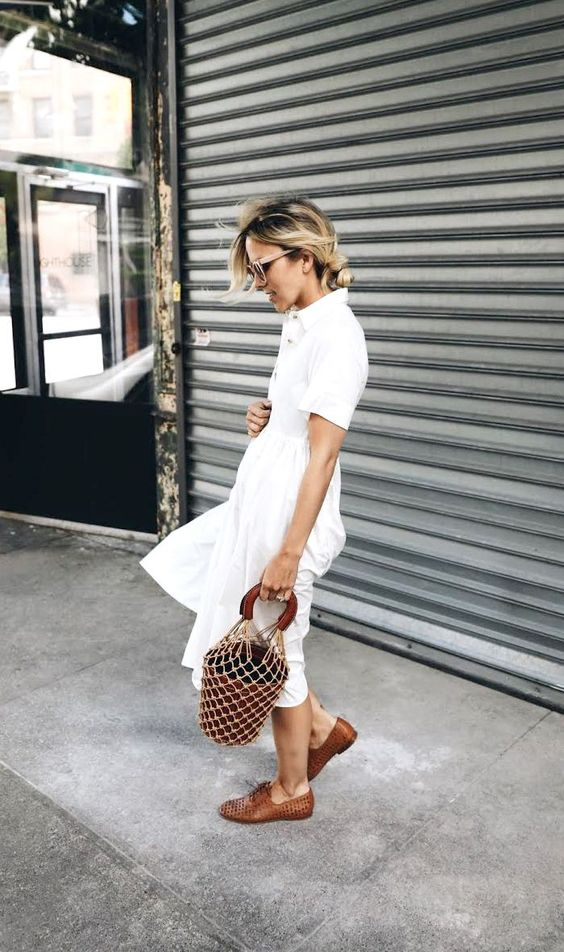 a white midi shirtdress with an A-line skirt, brown perforated shoes and a bucket bag for summer