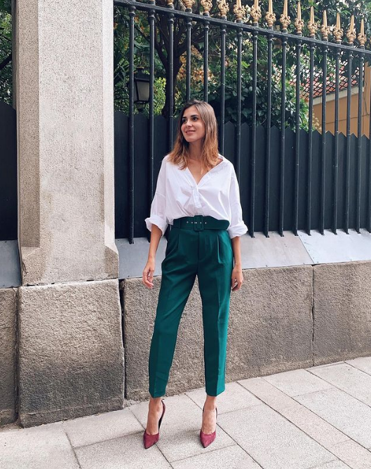 a white oversized shirt, emerald green high waisted cropped trousers, mauve shoes for a cool color combo