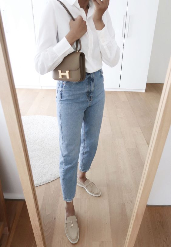 a white shirt, blue cropped jeans, tan loafers and a brown crossbody bag for a super simple look
